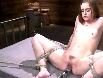Innocent babe sits in strange basement and nicely touches trimmed sissy with vibrator. After that, she is tied up to bed and penetrated in several sex