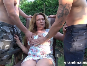 horny milf didn't think twice before having two hard dicks in her mouth