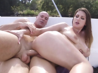 Lovely woman is getting her tits fucked on the boat by her lover and she is smiling as she is feeling his large cock brushing against her big bouncy b