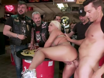 When a girl has flames tattooed on her pierced pussy, you just know you're dealing with a freak! This blonde freak gets taken to a biker bar by h