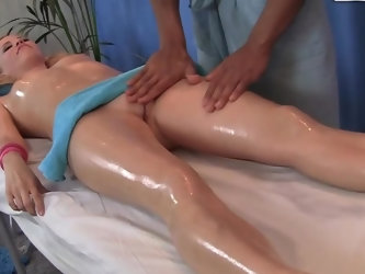 Even though this blonde came in for a relaxing massage, she wasn't expecting this type of body rub. After covering her body in essential oil, the