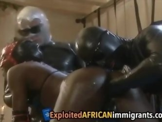 Black woman in leather gets her asshole fisted