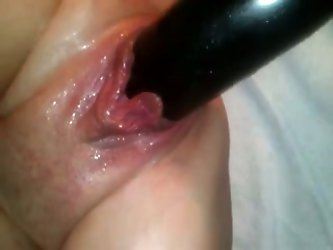 Check out this huge soaking wet milf hole of my German wife. I stuff a black rubber dildo in it and film on POV homemade video.